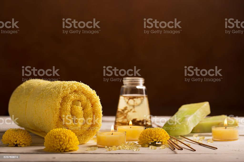 SPA still life with towel, candles and flowers stock photo