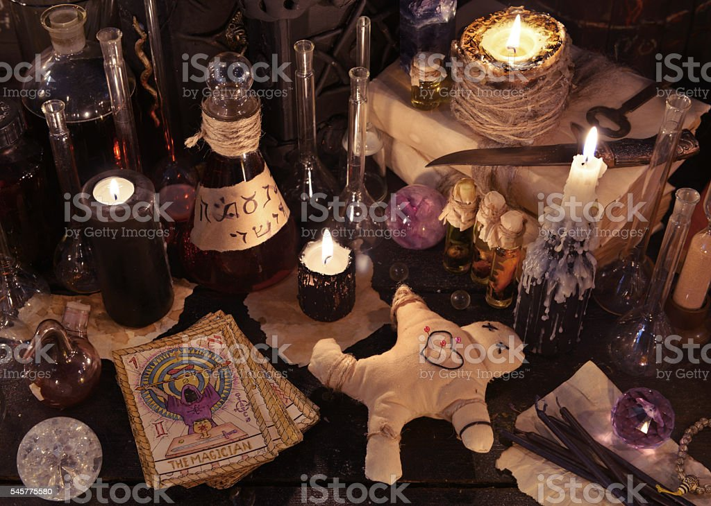 Still life with voodoo doll, tarot cards and magic objects stock photo