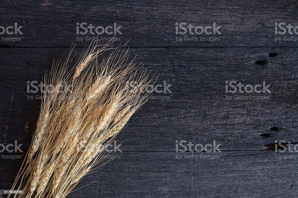 Still life with wheat on old wooden table stock photo