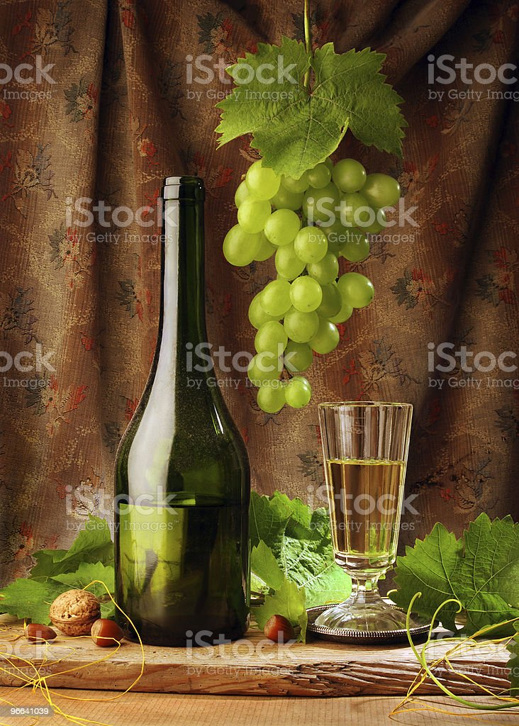 Still life with wine and hanging grape royalty-free stock photo
