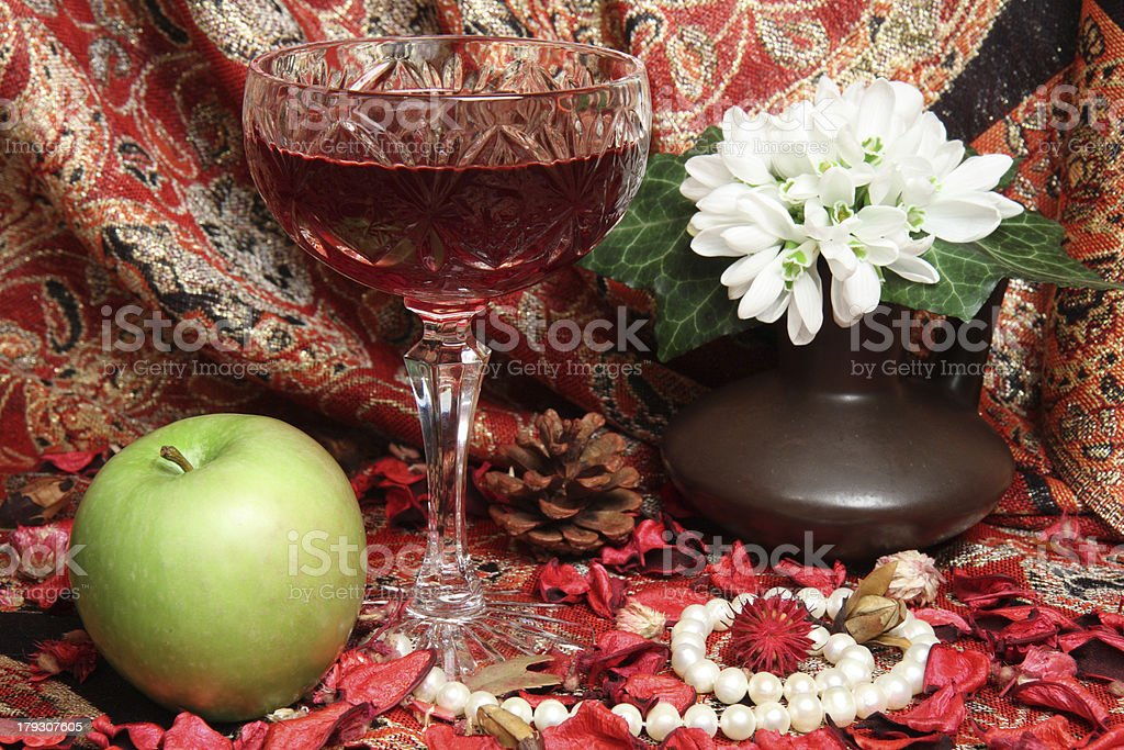 Still life with wine, apple and flowers royalty-free stock photo