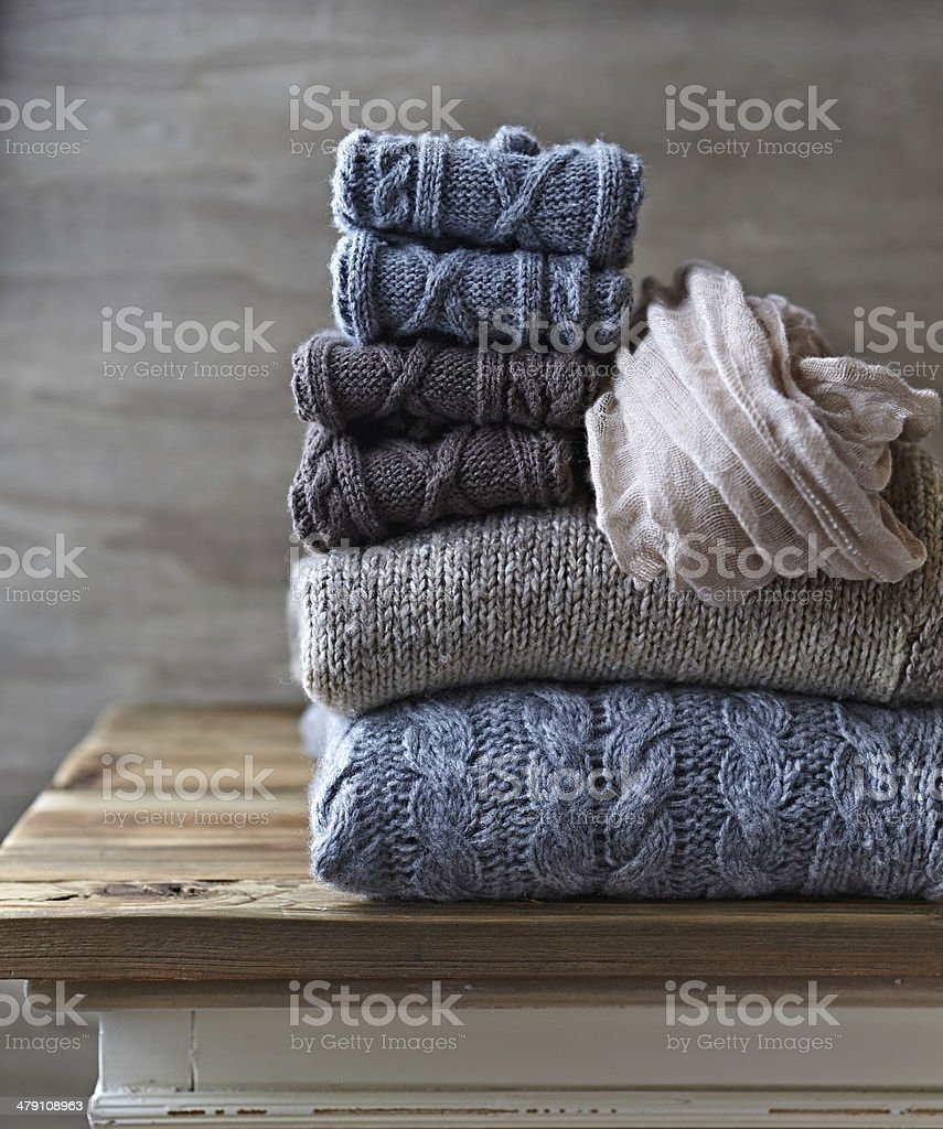 Still Life with Wool Sweaters and Leg Warmers stock photo