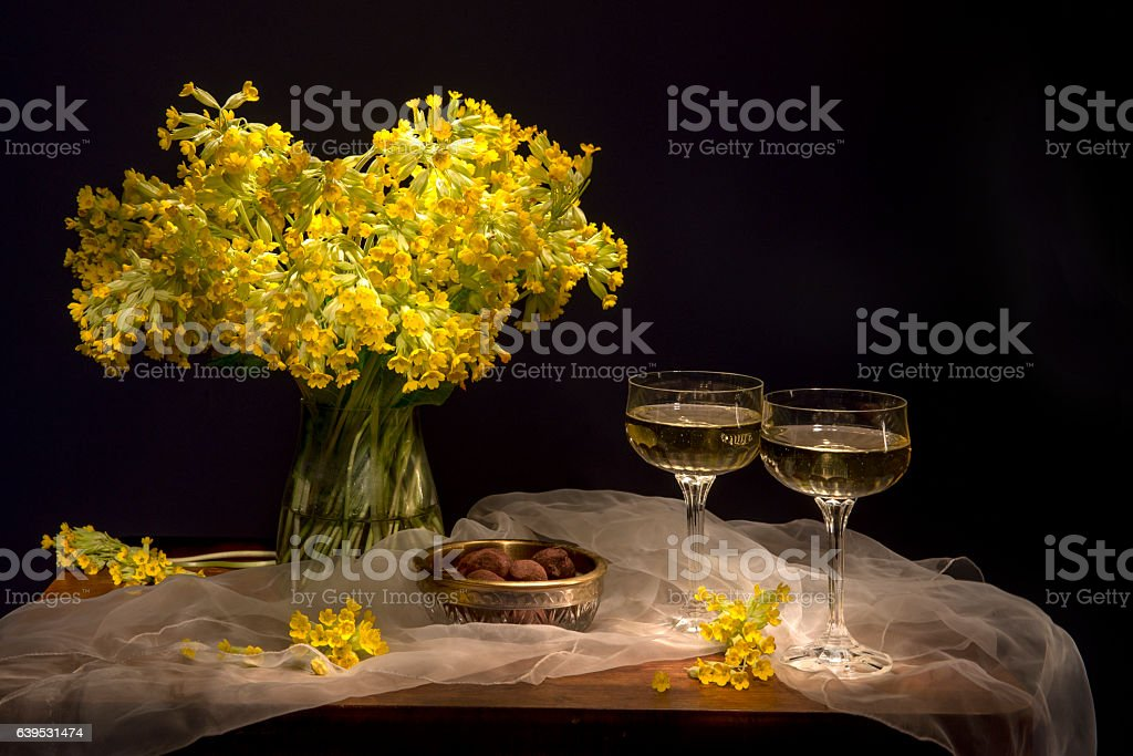 Still life with yellow flowers - cowslips stock photo