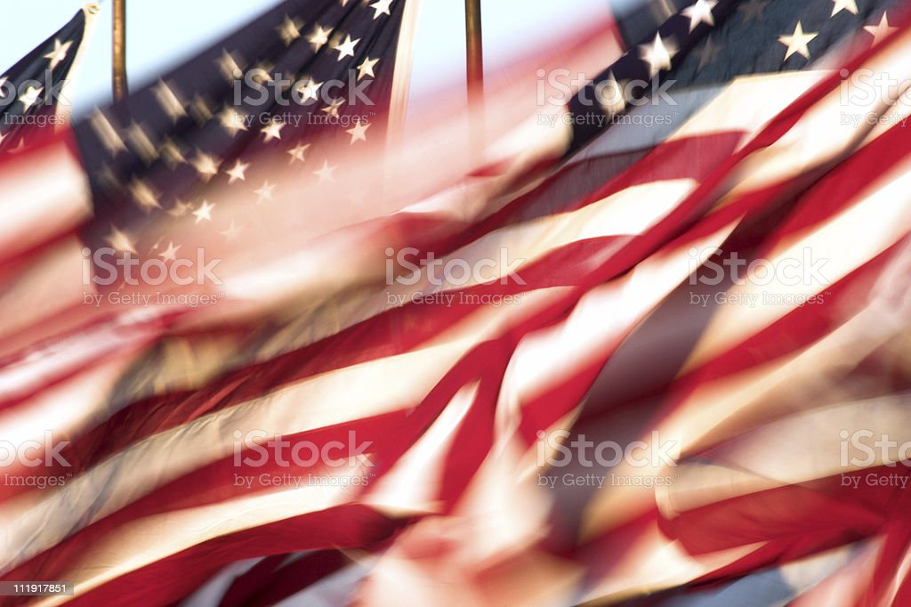 Still shot of American flags whipping in the wind royalty-free stock photo