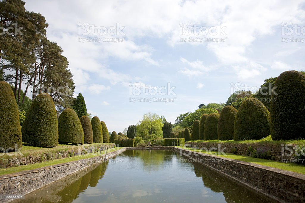 Still water and topiary garden royalty-free stock photo