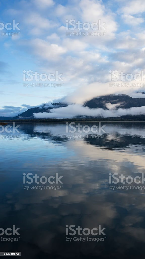 Still water with cloud reflections stock photo
