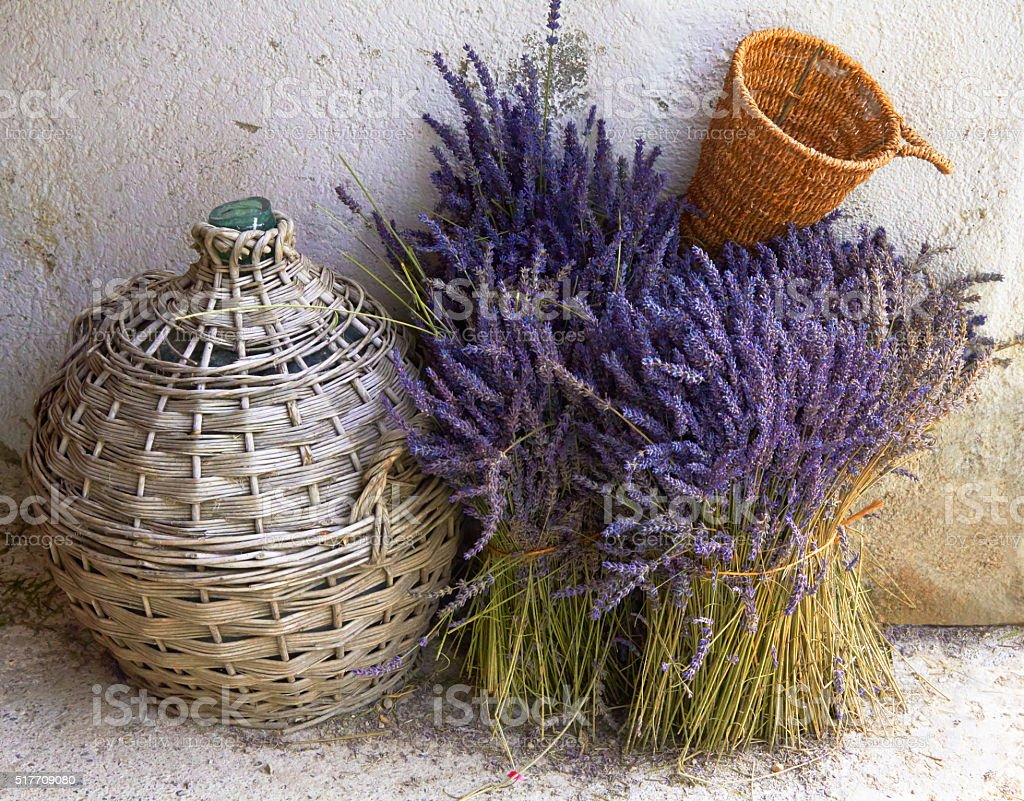 Still-life with a bouquet of lavender basket and bottle stock photo