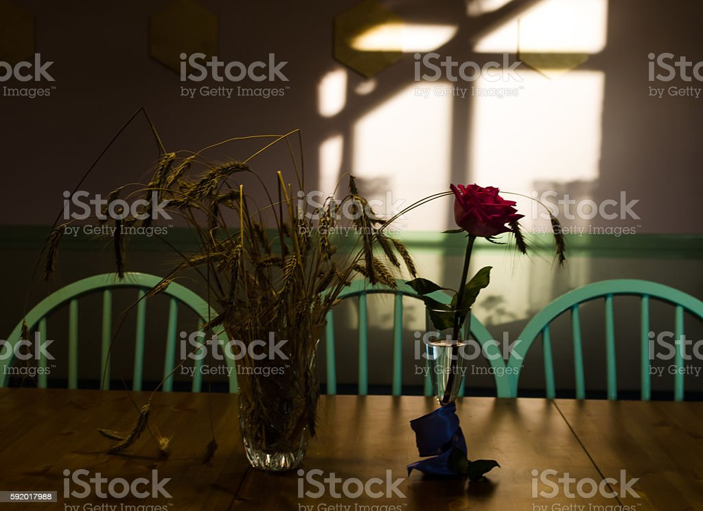 still-life with a rose and wheat stock photo
