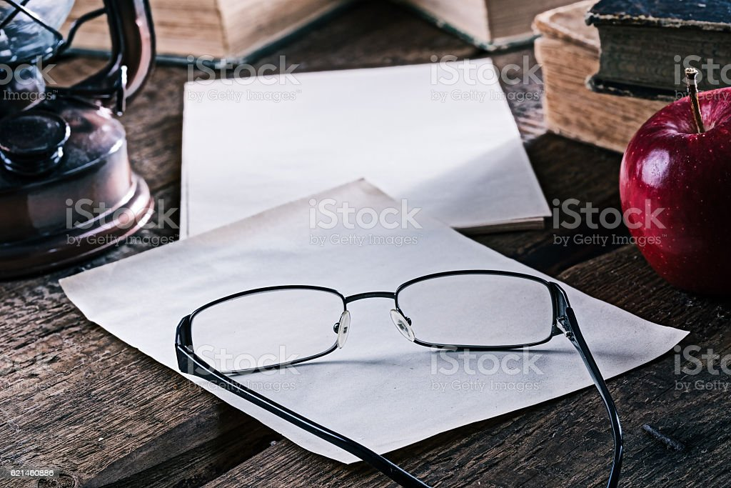 Still-life with books and eyeglasses stock photo