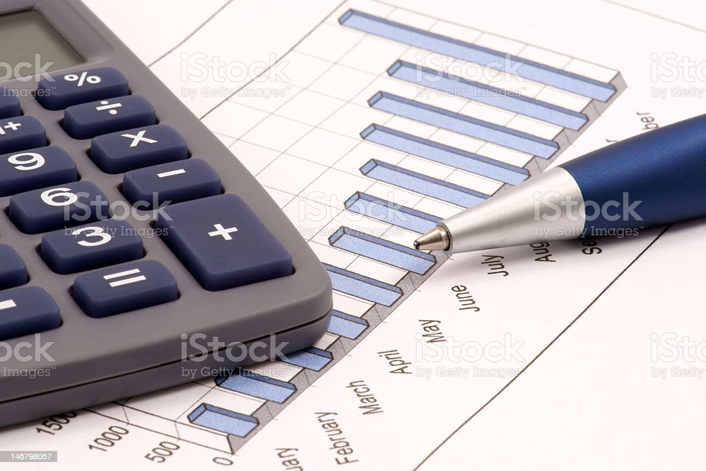 Still-life with calculator, pen and diagram royalty-free stock photo