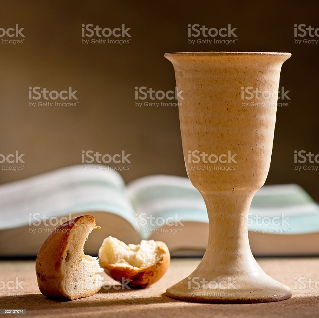stilllife with chalice of wine, bible and bread stock photo