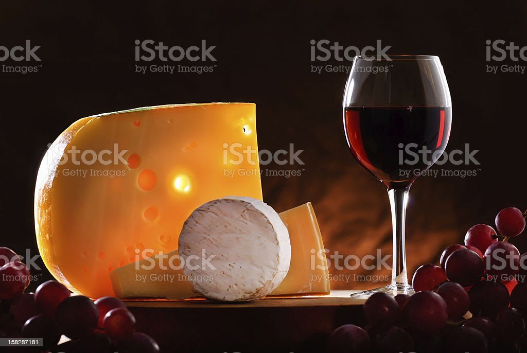 Still-life with cheese, grape and wine. royalty-free stock photo