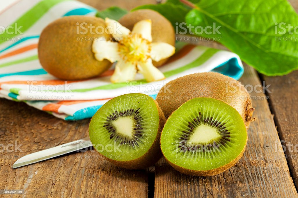 Still-life with fresh kiwi fruits stock photo