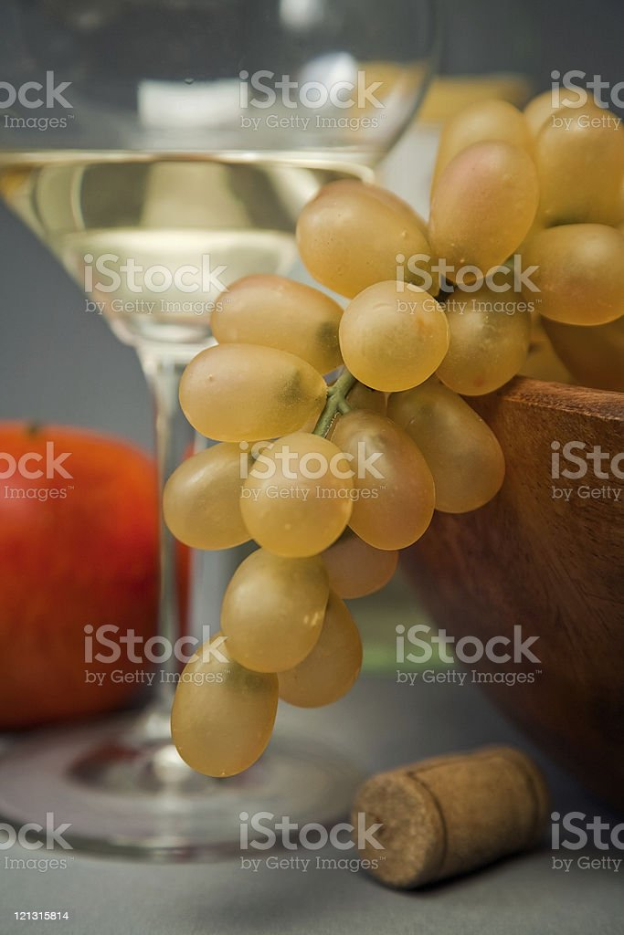 Still-life with fruit and wine glass stock photo