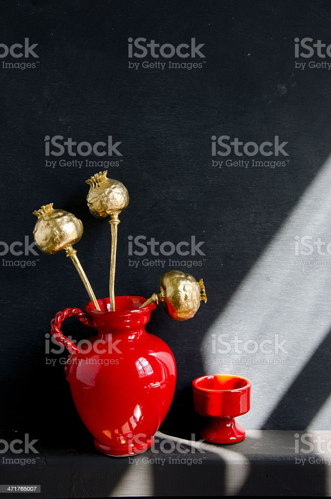 still-life with golden poppy heads and jug royalty-free stock photo