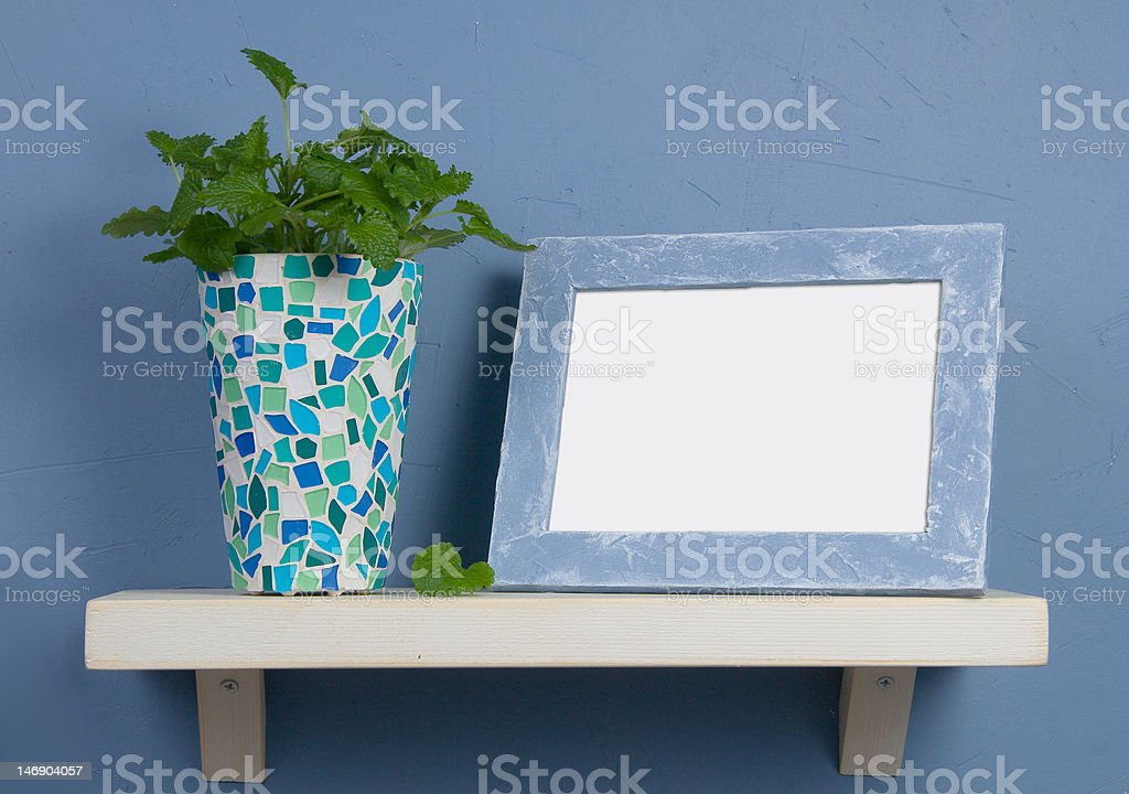 Still-life with mosaic vase and frame royalty-free stock photo
