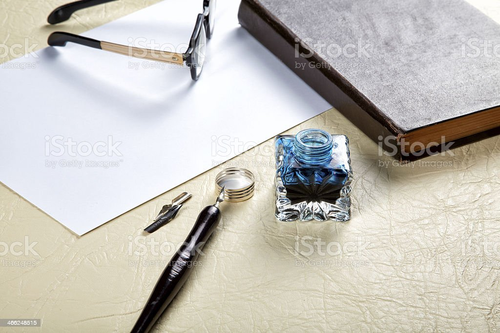 Still-life with the old Ink pot and quill royalty-free stock photo