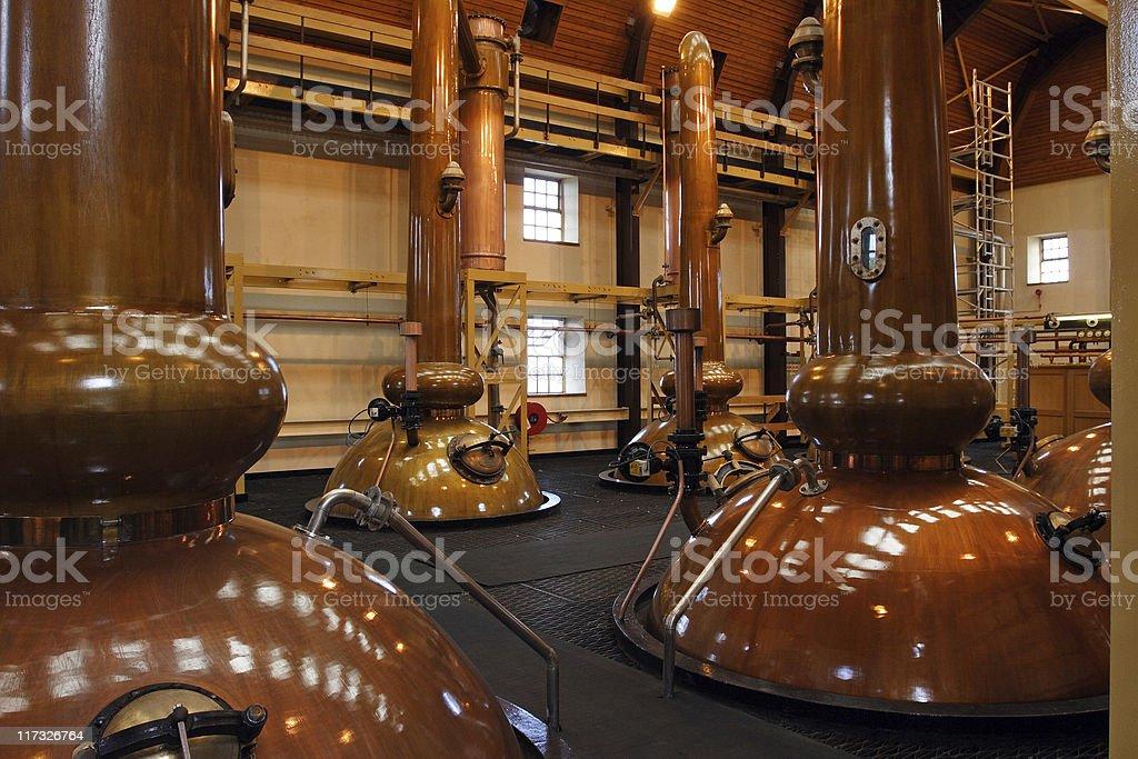 Stills in a whisky distillery stock photo