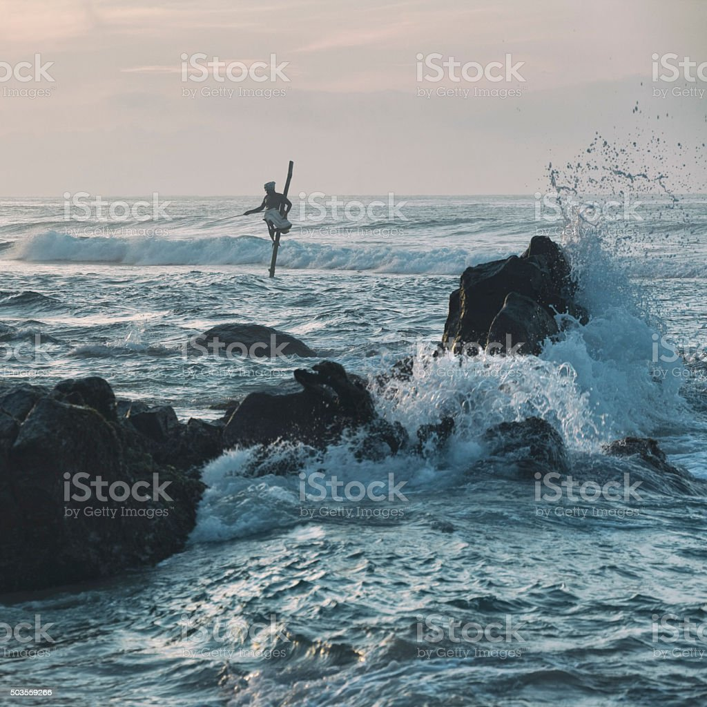 Stilt Fisherman in Weligama, Sri Lanka stock photo