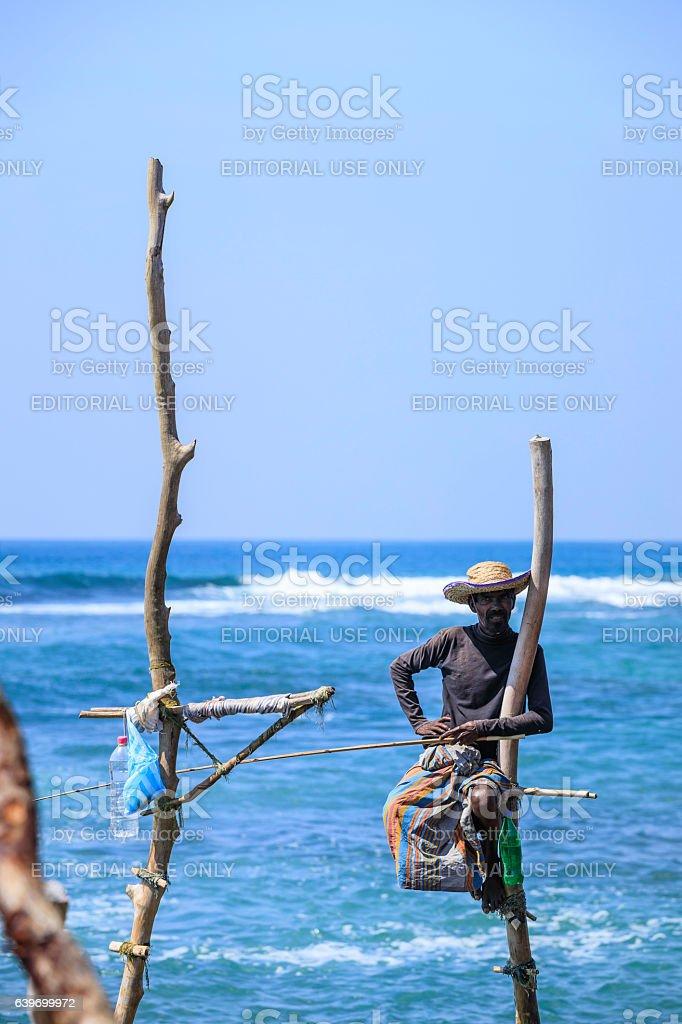 stilt fisherman of Sri Lanka (traditional fishing) stock photo