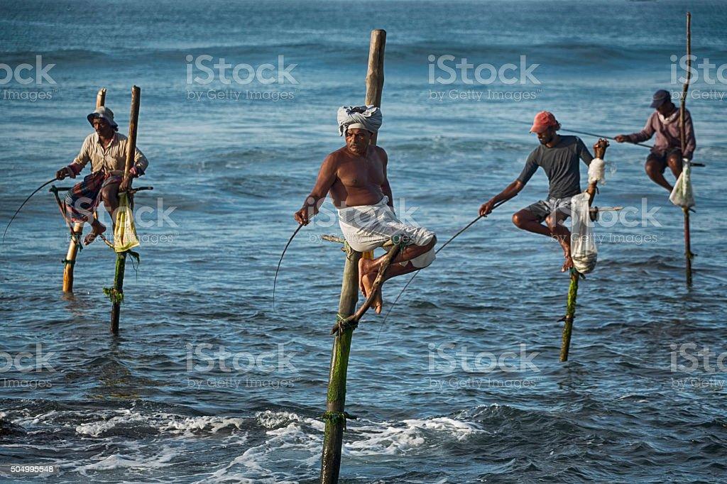 Stilt Fishermen in Weligama, Sri Lanka stock photo
