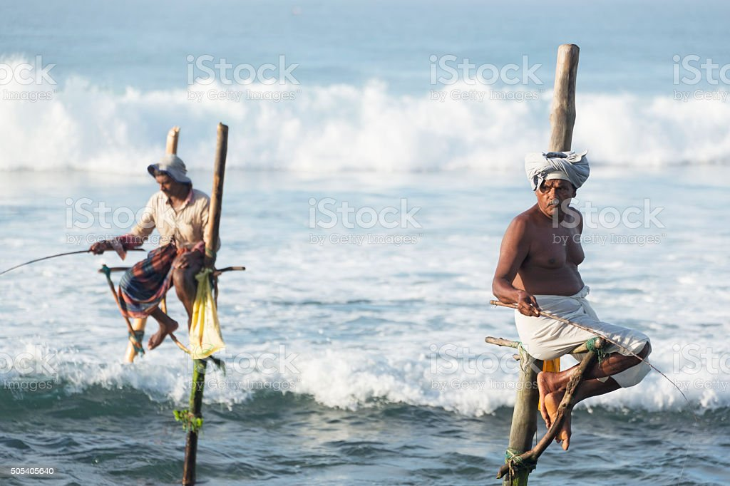 Stilt Fishermen in Weligama, Sri Lanka stock photo