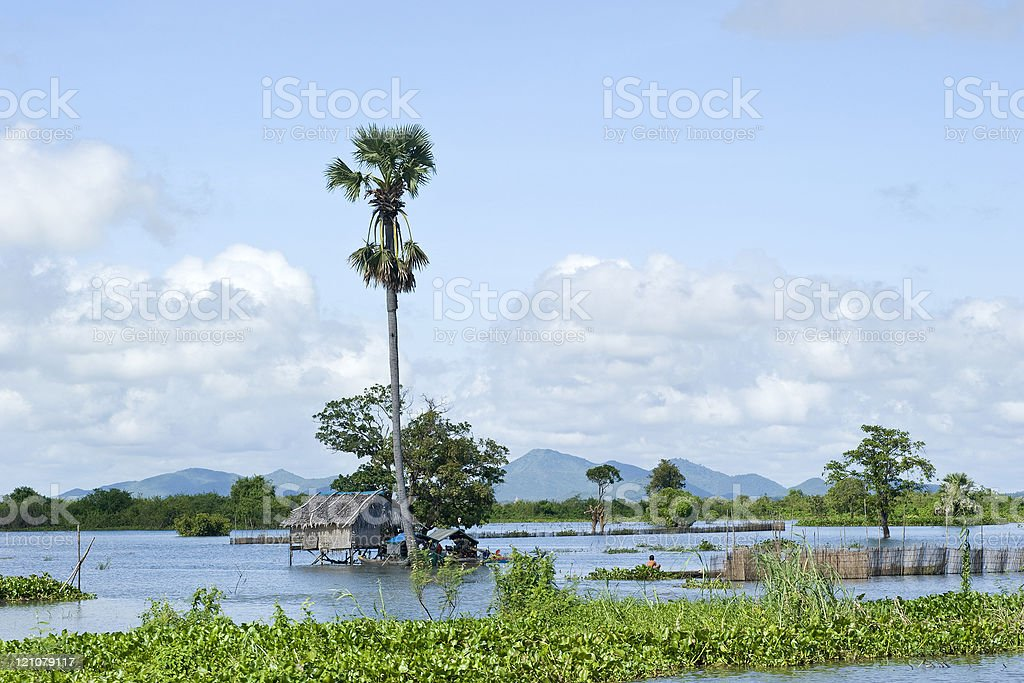 Stilt house in a floating village, Tonle Sap, Cambodia royalty-free stock photo