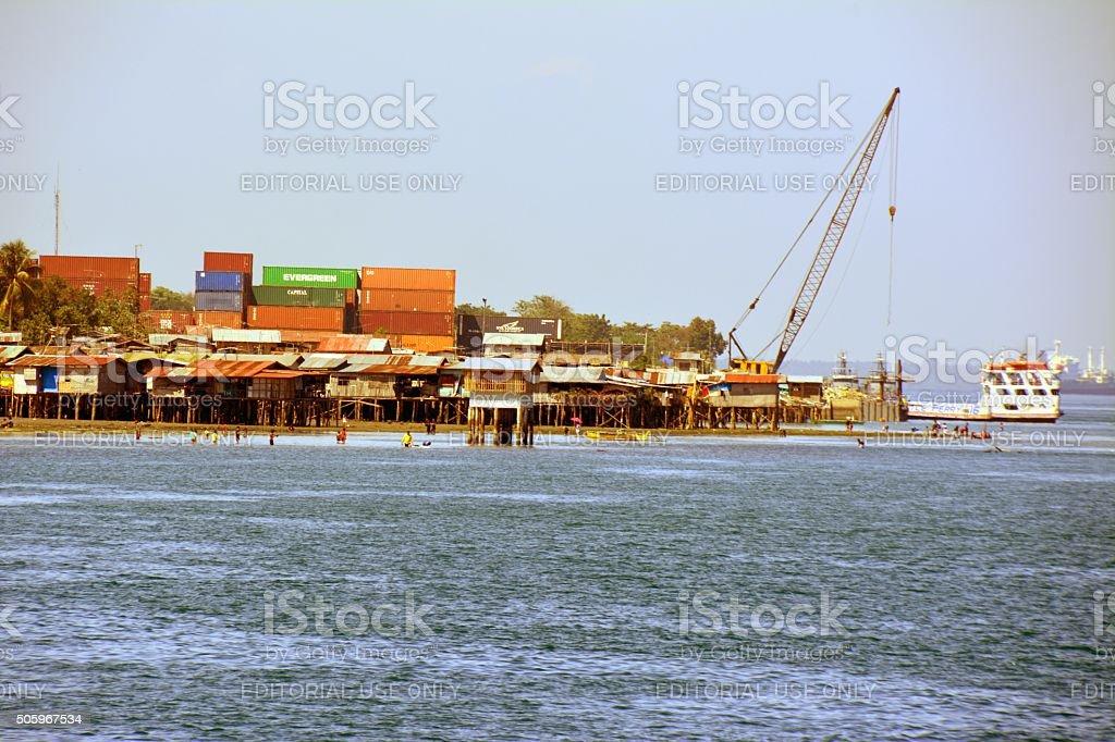 Stilt houses on Davao waterfront, Mindanao stock photo