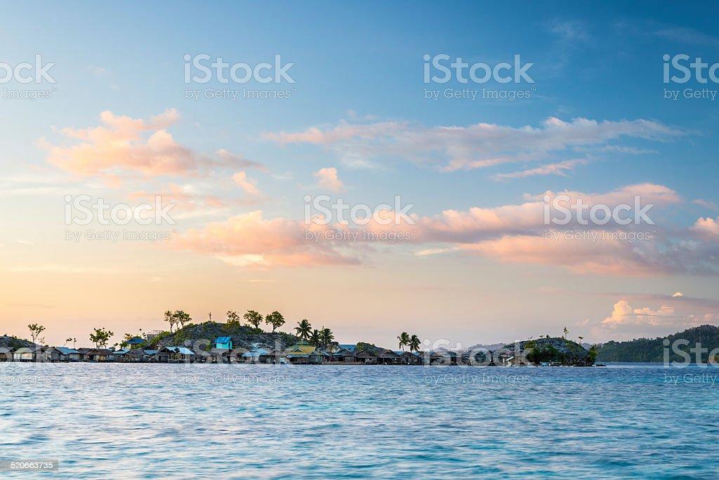 Stilt village at sunrise stock photo