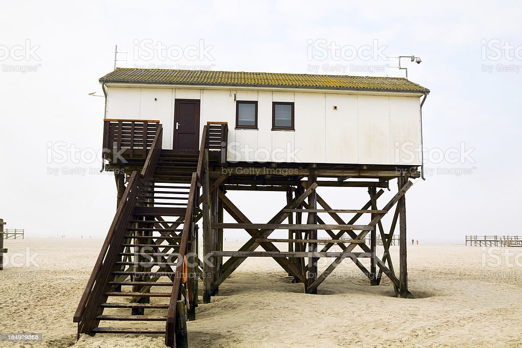 Stilted house at beach stock photo