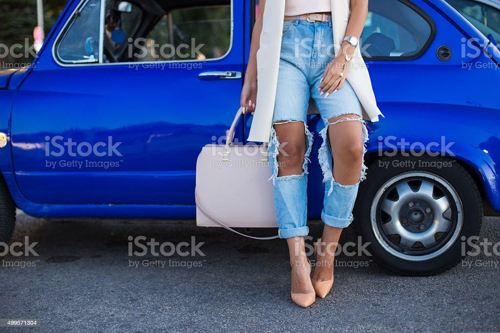 Stilysh woman with her deep blue oldtimer car! stock photo