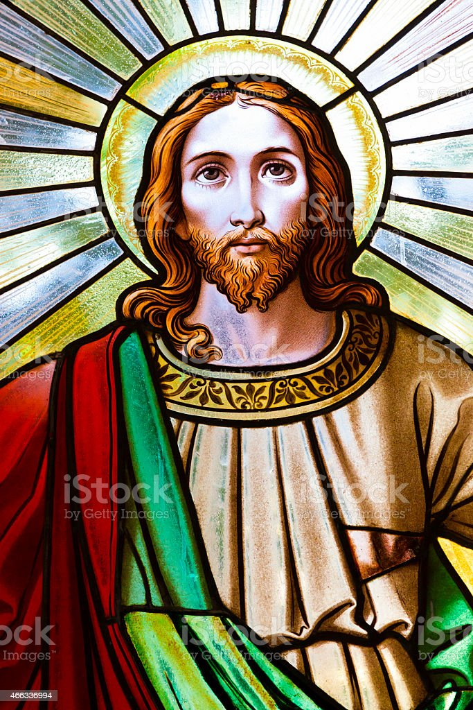 Stined glass church window of Jesus Christ stock photo