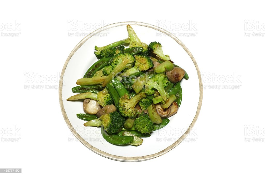 Stir fried broccoli and green peas, Asian style stock photo