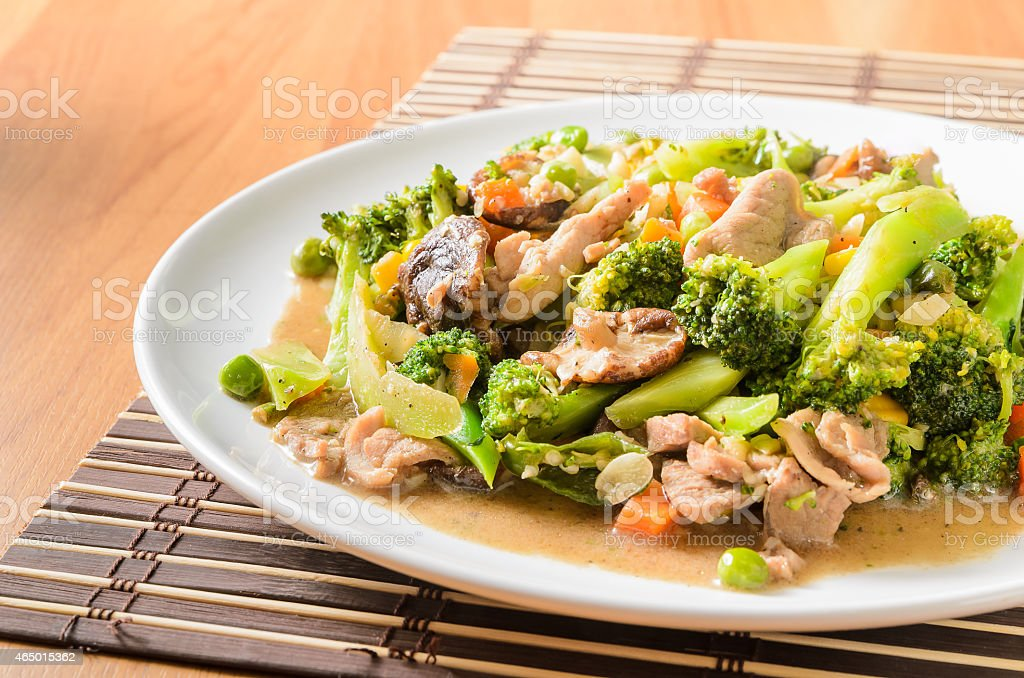 Stir fried Broccoli and mix vegetables with pork stock photo