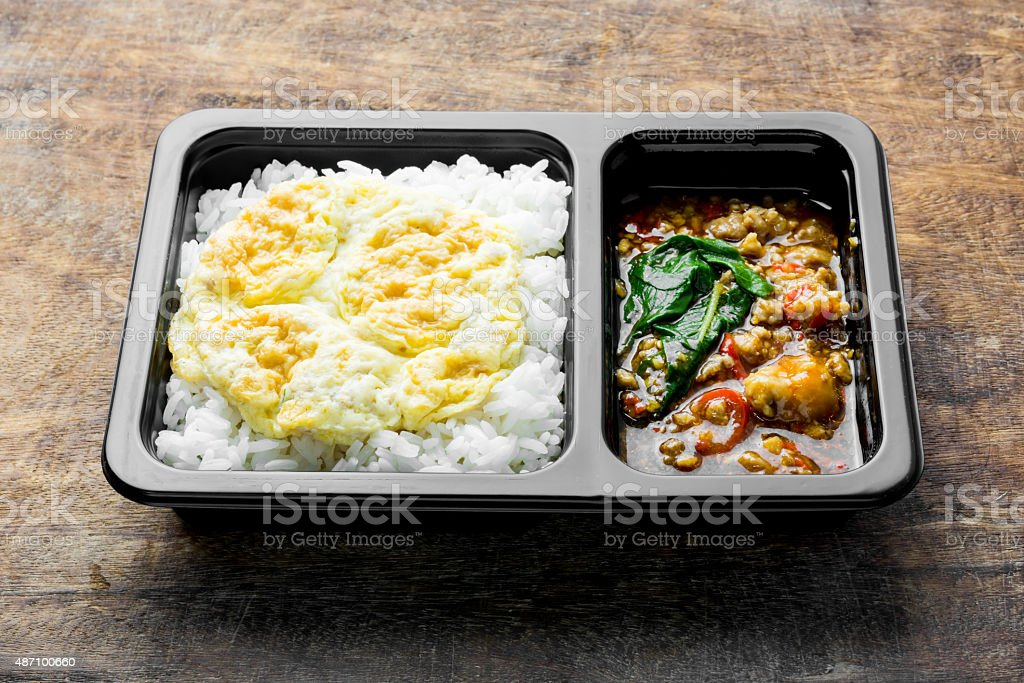 Stir Fried Chicken with Basil over Rice and Omelette stock photo