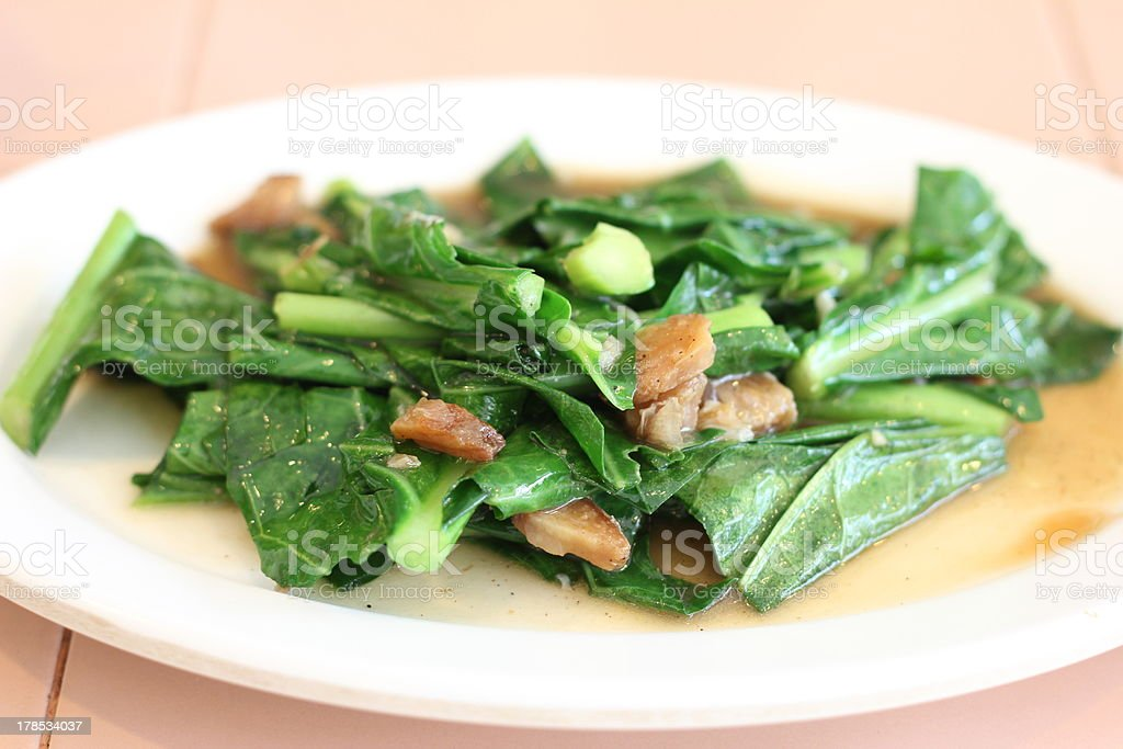 Stir Fried Chinese Kale with Salted Fish, Thai food royalty-free stock photo