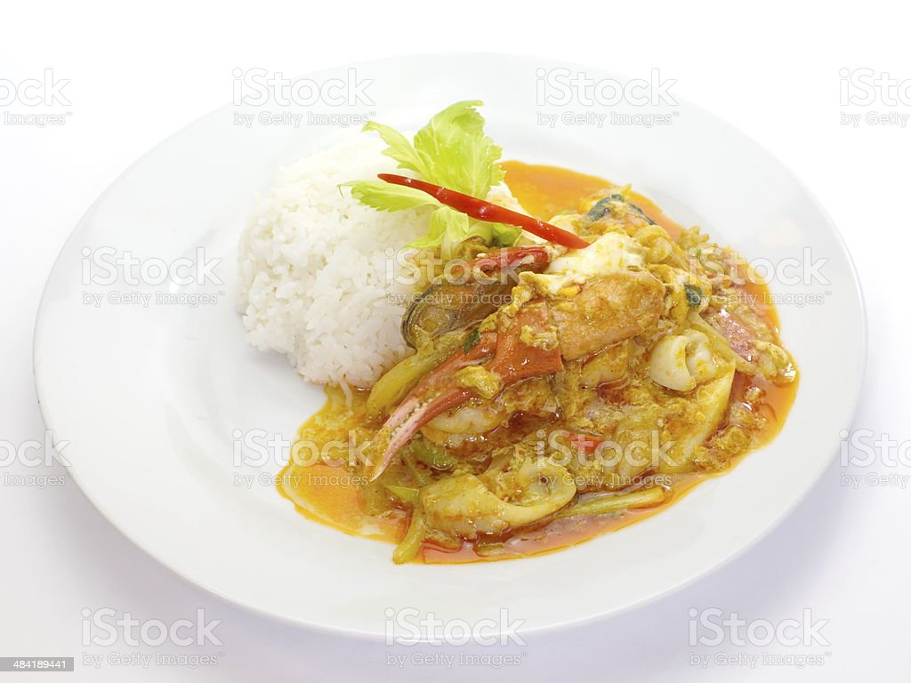 stir - fried crab with curry powder and white rice stock photo