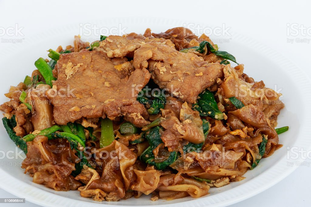 Stir fried flat noodle and pork with dark soy sauce. stock photo