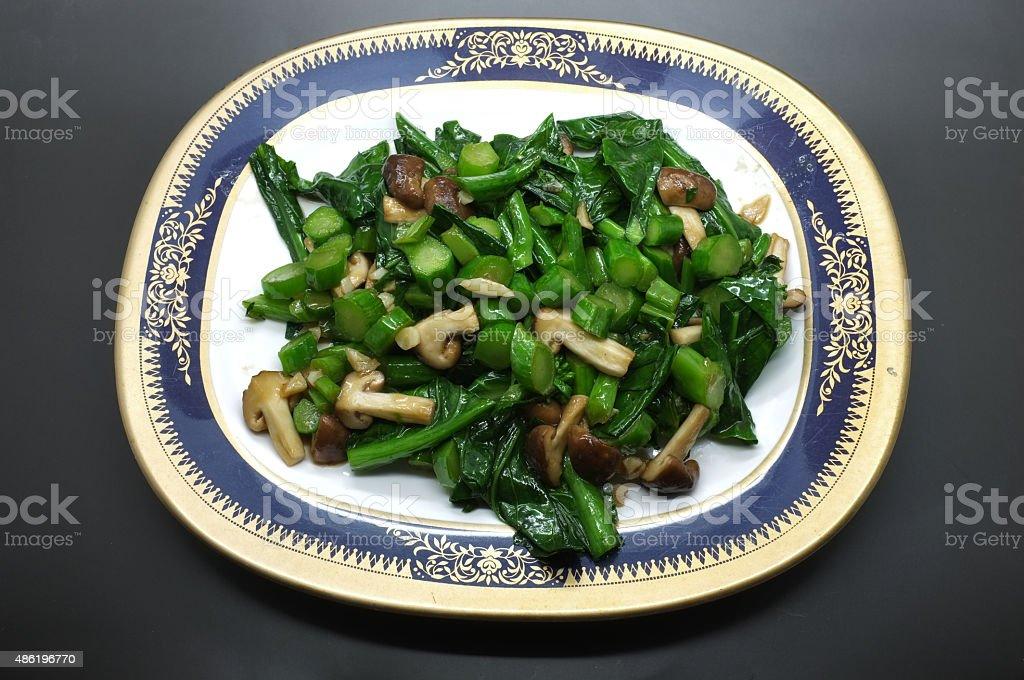 Stir fried green kale and mushroom stock photo