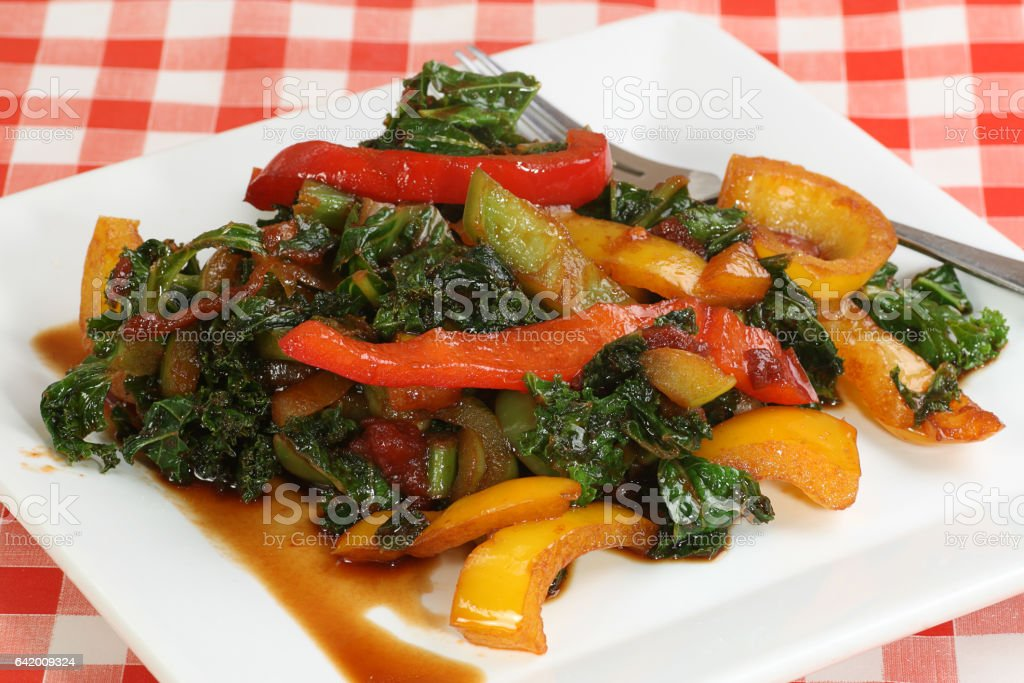 stir fried kale and peppers stock photo