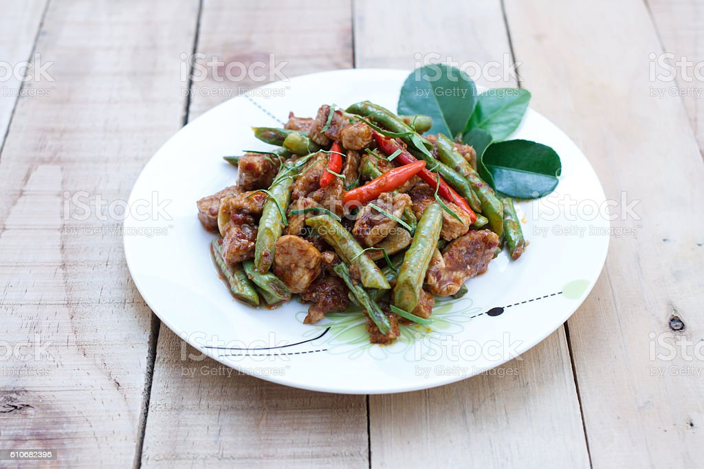 stir fried pork and red curry paste with string bean stock photo