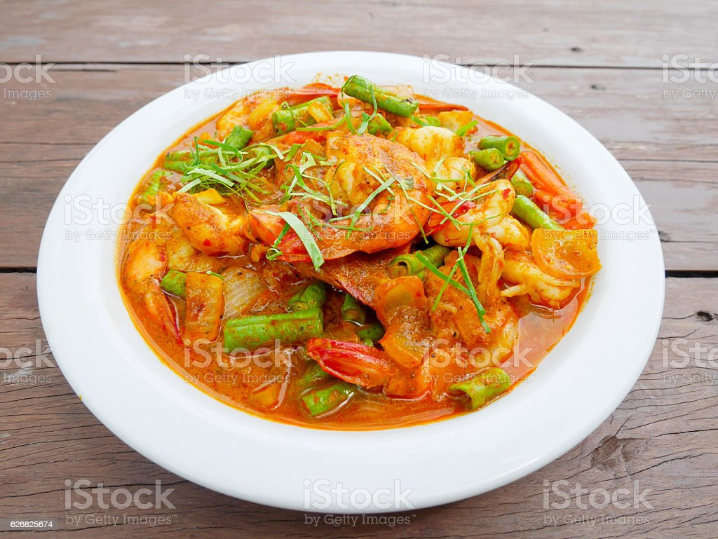Stir fried prawn with chili paste on wooden table. stock photo