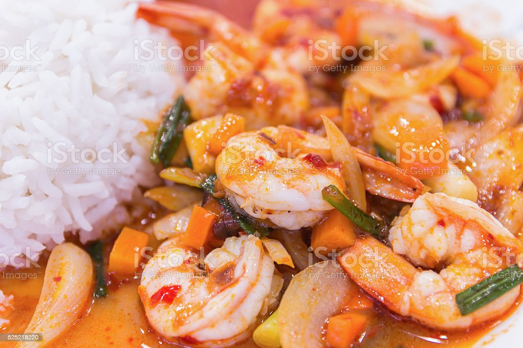 stir fried shrimp in thai red curry paste stock photo