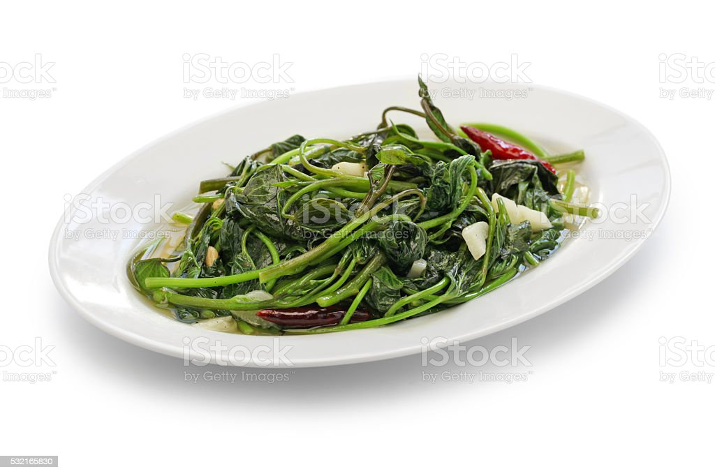 stir fried sweet potato leaves with garlic stock photo