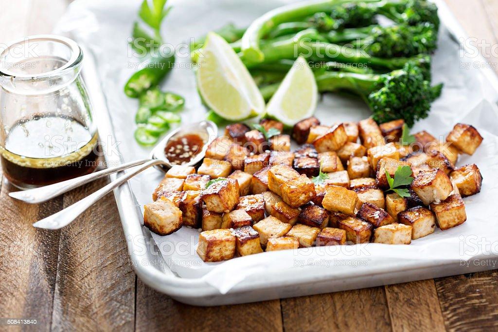Stir fried tofu in a baking pan stock photo