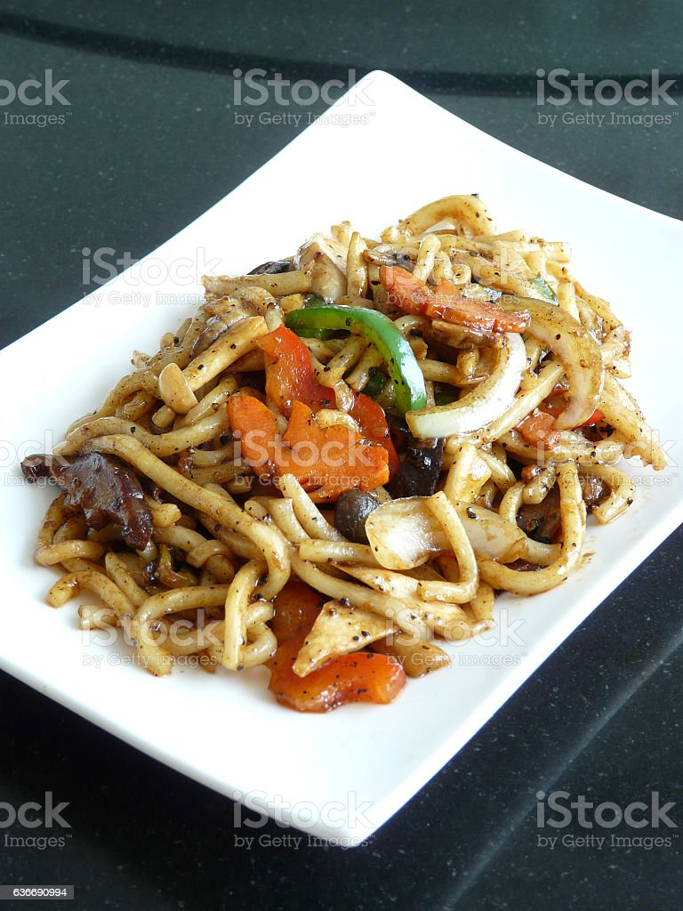 stir fried u dong with vegetables in black pepper sauce stock photo