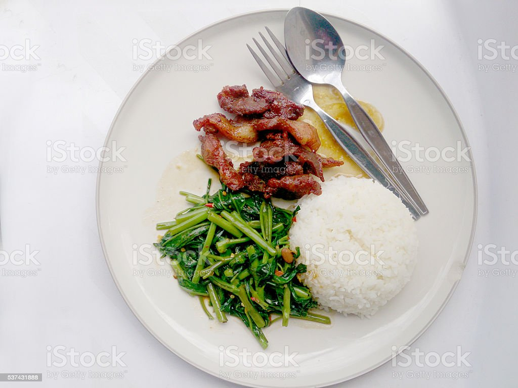 Stir Fried Water Spinach and Fried pork with rice stock photo