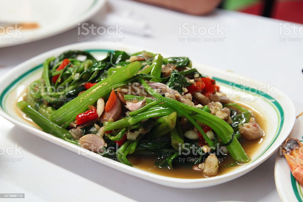 Stir Fried Water Spinach with garlic stock photo