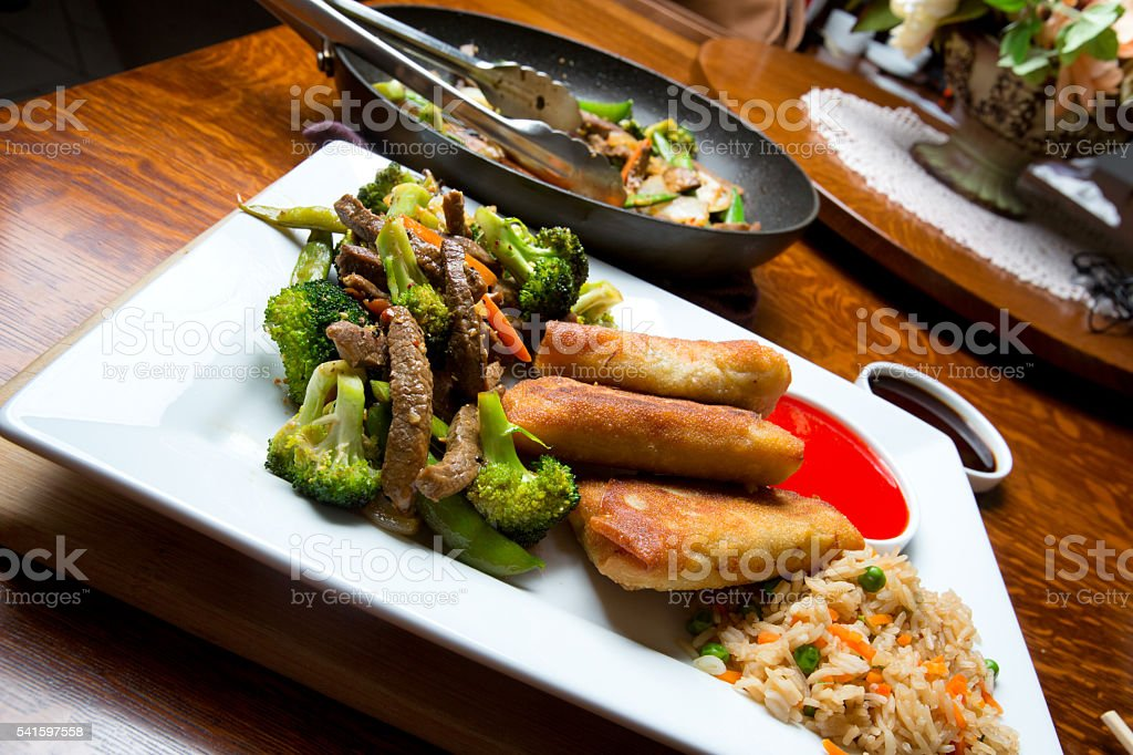 Stir Fry and Egg Rolls stock photo