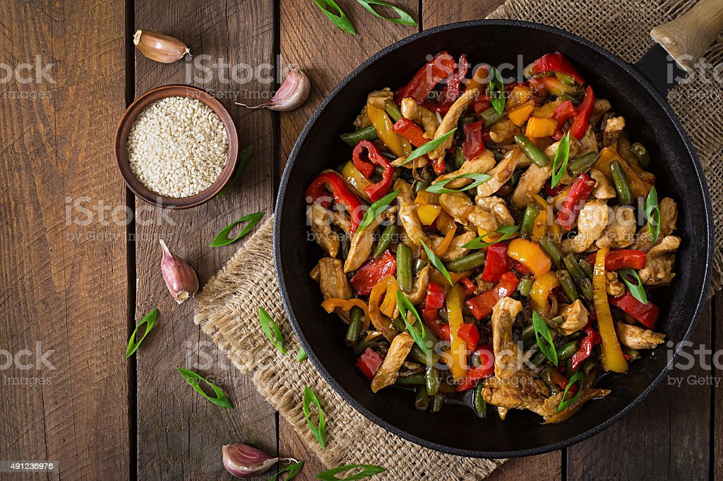 Stir fry chicken, sweet peppers and green beans stock photo